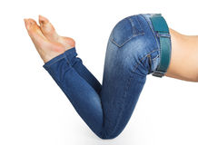 Close up of woman legs with jeans and barefoot Stock Images