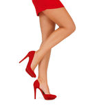 Close up of woman legs in red high heeled shoes stock photo