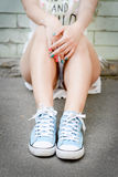 Close up of woman legs in trendy sneakers outdoor Stock Photos