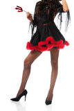 Close up on woman legs wearing devil clothes Royalty Free Stock Photo