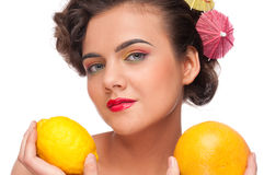 Close up woman with lemon and grapefruit Stock Photos