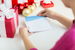 Close up of woman with letter and presents Royalty Free Stock Images