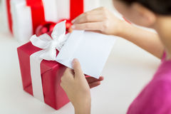 Close up of woman with letter and presents Royalty Free Stock Photos