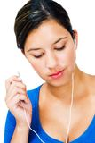 Close-up of a woman listening mp3 Royalty Free Stock Photo