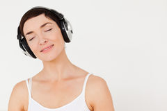 Close up of a woman listening to music Royalty Free Stock Photo