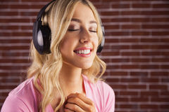 Close up of a woman listening to music Royalty Free Stock Images