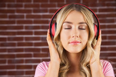 Close up of a woman listening to music Royalty Free Stock Image