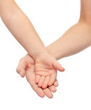 Close up of woman and little child hands together Stock Photo