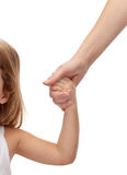 Close up of woman and little girl holding hands Stock Images