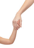 Close up of woman and little girl holding hands Stock Photos