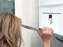 Woman and gas boiler stock photo