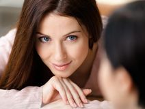 Close up of woman looking at another one Royalty Free Stock Photos