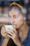Close up of woman looking away while drinking coffee Royalty Free Stock Photo