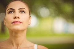 Close-up of woman looking away. At park Stock Photos