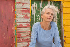 Close up of woman looking away. While standing against beach hut Royalty Free Stock Photography