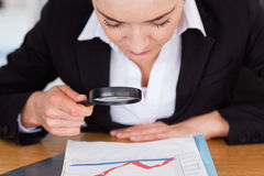 Close up of a woman looking at a chart Stock Image