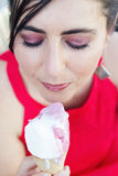 Close up of woman looking at melting ice cream cone Royalty Free Stock Photos