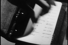 Close-up of woman looking through names in her binder stock video footage
