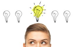 Close up of woman looking to lighting bulbs Stock Images