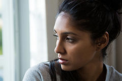 Close-up of woman looking through window Royalty Free Stock Photos