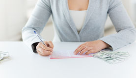 Close up of woman with lottery ticket and money Royalty Free Stock Photography