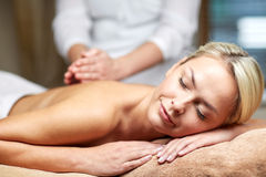 Close up of woman lying and having massage in spa Stock Photo