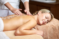 Close up of woman lying and having massage in spa Royalty Free Stock Images