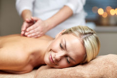 Close up of woman lying and having massage in spa Royalty Free Stock Photography
