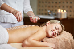 Close up of woman lying and having massage in spa Stock Image