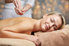 Close up of woman lying and having massage in spa Royalty Free Stock Photos