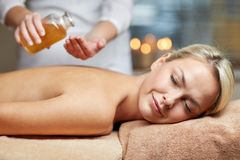 Close up of woman lying on massage table in spa Royalty Free Stock Photos