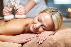 Close up of woman lying on massage table in spa Royalty Free Stock Image