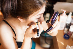 Close up woman in makeup Stock Photography