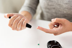 Close up of woman making blood test by glucometer Royalty Free Stock Photos