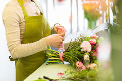 Close up of woman making bunch at flower shop royalty free stock image