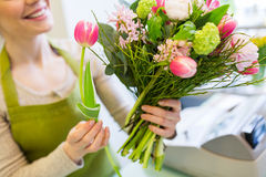 Close up of woman making bunch at flower shop royalty free stock images