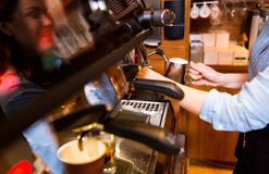 Close up of woman making coffee by machine at cafe Stock Photography