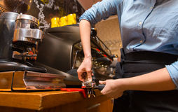 Close up of woman making coffee by machine at cafe Stock Images