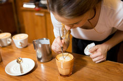 Close up of woman making coffee at shop or cafe Royalty Free Stock Photos