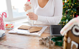 Close up of woman making gingerbread houses Stock Photography