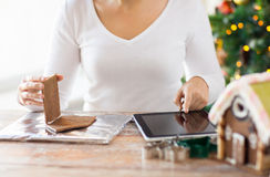 Close up of woman making gingerbread houses Royalty Free Stock Photo