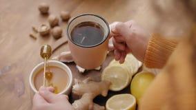 Hot tea with honey stock video
