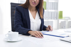 Close up of a woman making remarks in a document Stock Images