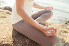 Close up of woman making yoga exercises outdoors Stock Photos
