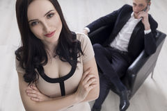 Close up of woman, man in background Stock Photo