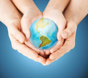 Close up of woman and man hands with earth globe. People, geography, population and peace concept - close up of women and men hands with earth globe showing royalty free stock photos