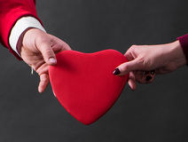 Close up of woman and man hands with heart Stock Photo