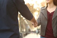 Close up of a woman and man handshking in the street. Close up of a happy women and men hands handshking in the street stock images