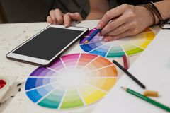 Close-up of woman matching color with color swatch Royalty Free Stock Photos