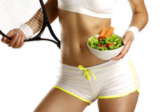 Close up of a woman measuring  hips with a salad in her hand Royalty Free Stock Image